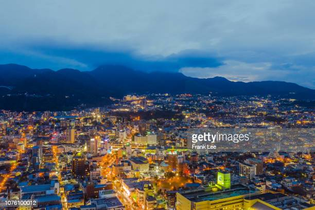 aerial panorama view of beppu cityscape from drone at sunset - 別府市 ストックフォトと画像