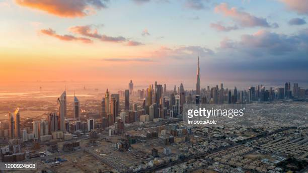 aerial panorama view of dubai cityscape with burj khalifa during morning sunrise - impossiable stock pictures, royalty-free photos & images