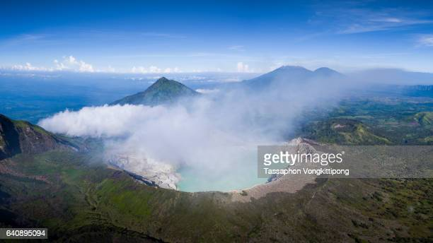 aerial panorama view of Kawah Ijen sulfer lake volcano crater in Indonesia