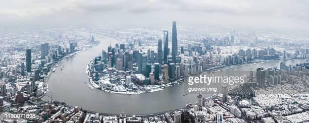 Aerial panoramic skyline of Shanghai under heavy snowfall