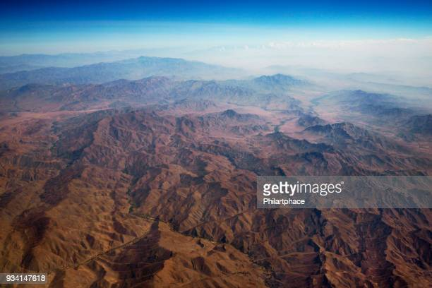 aerial panoramic view at mountain range from airplane above afghanistan - afghanistan stock pictures, royalty-free photos & images