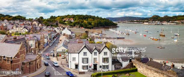 aerial panoramic view of conwy wales uk featuring village and marina - north wales stock pictures, royalty-free photos & images