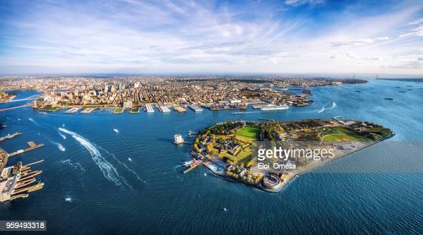 aerial panoramic view of governors island and brooklyn. new york. usa - governors island stock pictures, royalty-free photos & images