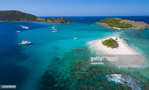 aerial panoramic view of sandy spit, british virgin islands - catamaran stock photos and pictures