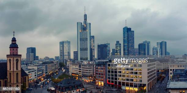 aerial panoramic view of the illuminated frankfurt am main skyline from hauptwache at dusk - frankfurt main tower stock pictures, royalty-free photos & images