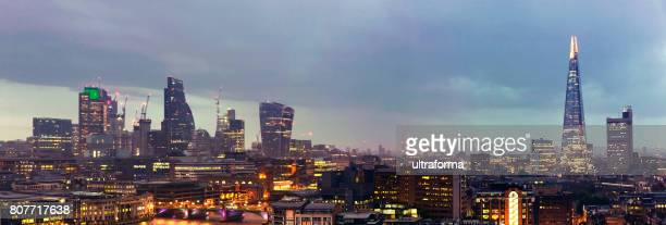 aerial panoramic view of the shard and city of london at dusk - london docklands stock pictures, royalty-free photos & images