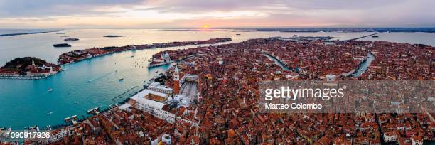 aerial panoramic view of venice at sunset, italy - canale grande venedig stock-fotos und bilder