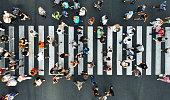 Aerial. Pedestrians on pedestrian crosswalk. Top view.