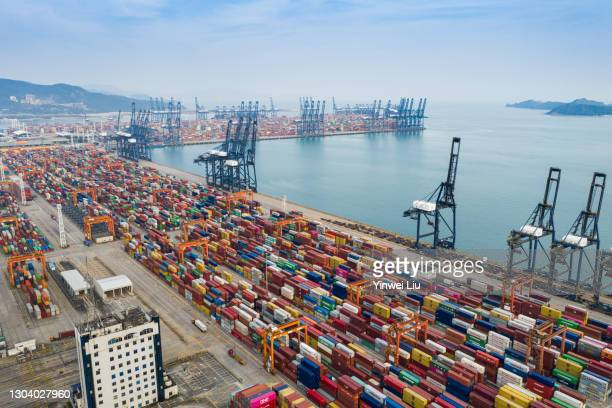 aerial perspective of a container port - tariff stock pictures, royalty-free photos & images