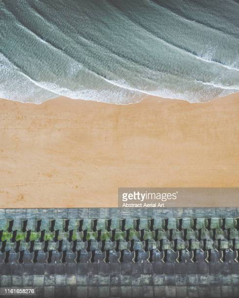 aerial perspective of a walkway, a beach and the ocean, united kingdom - liverpool england stock pictures, royalty-free photos & images