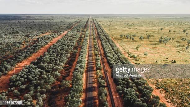 aerial perspective of an outback road, western australia - western australia stock-fotos und bilder