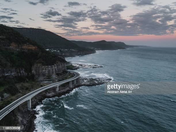aerial perspective of sea cliff bridge, new south wales, australia - south australia stock pictures, royalty-free photos & images