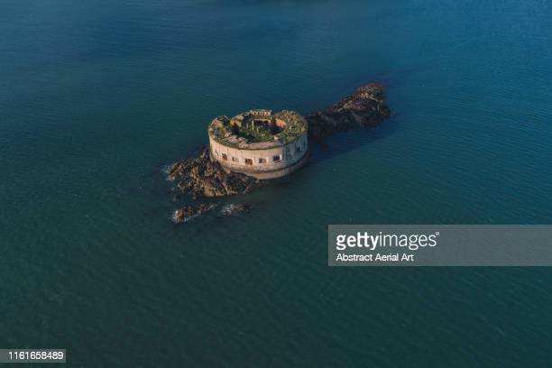 aerial perspective of stack rock fort, wales, united kingdom - military stock pictures, royalty-free photos & images