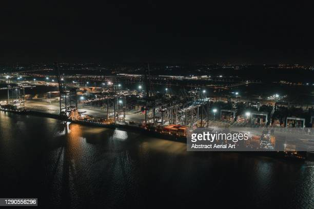 aerial perspective showing london gateway port at night, england, united kingdom - harbour stock pictures, royalty-free photos & images