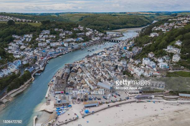 aerial perspective showing the town of looe, cornwall, united kingdom - shallow stock pictures, royalty-free photos & images