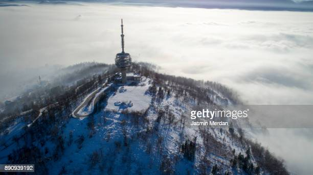 Aerial photo from drone of telecommunication tower between winter fog