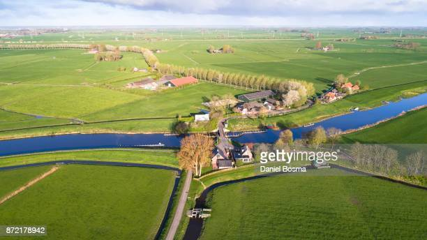 aerial photo of a green and typical dutch rural landscape - ditch stock photos and pictures