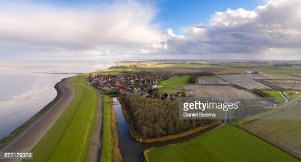 Aerial photo of a historical village called Wierum and its hinterland