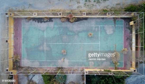 Aerial photo of abandoned colourful tennis playground