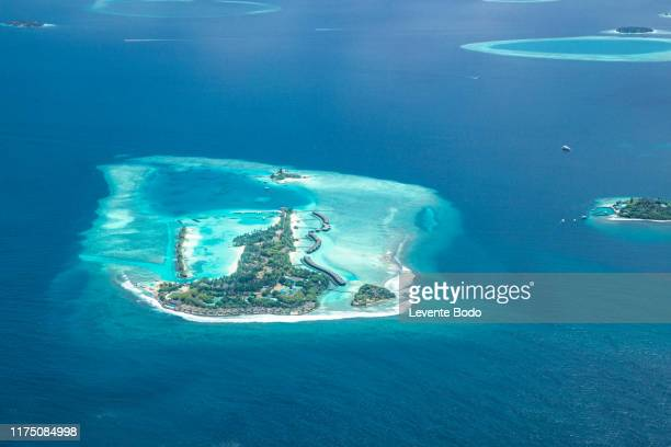 aerial photo of beautiful paradise maldives tropical beach on island. summer and travel vacation concept. - french overseas territory stock pictures, royalty-free photos & images