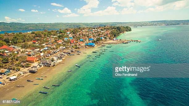 aerial photo of coast line in makasar island - helicopter photos stock pictures, royalty-free photos & images