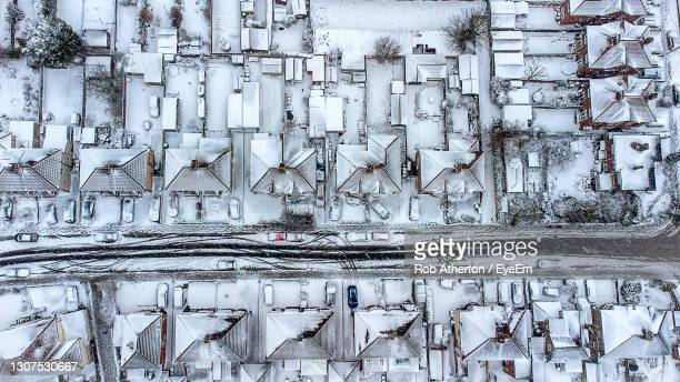 aerial photo of drone footage of ipswich following heavy snowfall from storm darcy in february 2021 - extreme weather stock pictures, royalty-free photos & images