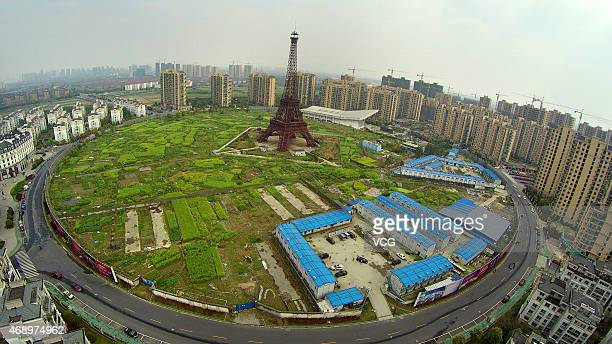 Aerial photo of 'Eiffel Tower' is seen on April 8 2015 in Hangzhou Zhejiang province of China A 108meterhigh replicate of Eiffel Tower lies in the...