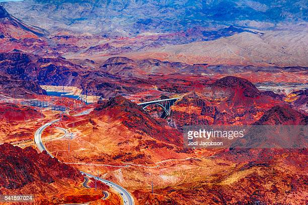 aerial photo of hoover dam and a bypass bridge - hoover dam stock photos and pictures