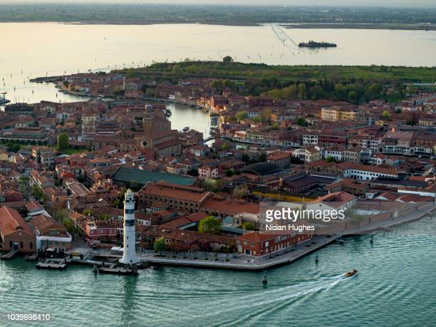 aerial photo of island of murano in venice italy, sunset - murano stock pictures, royalty-free photos & images