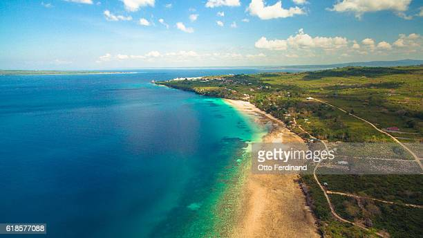 aerial photo of nirwana beach in bau-bau, southeast sulawesi - helicopter photos stock pictures, royalty-free photos & images