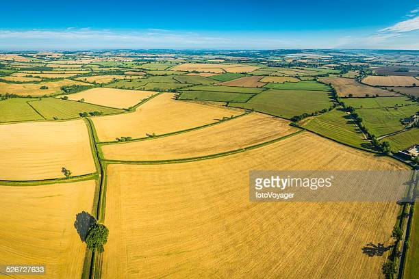 Aerial photo of rural crop fields green pasture idyllic countryside