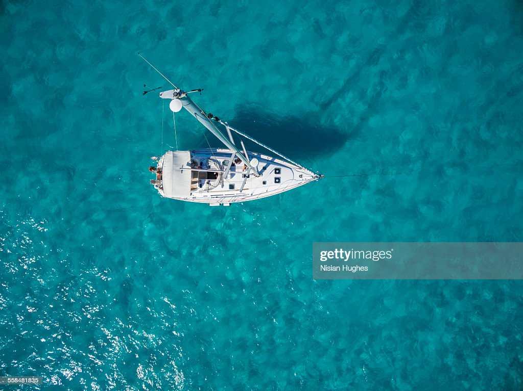 Aerial photo of sailboat anchored : Stock Photo