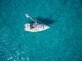 Aerial photo of sailboat anchored