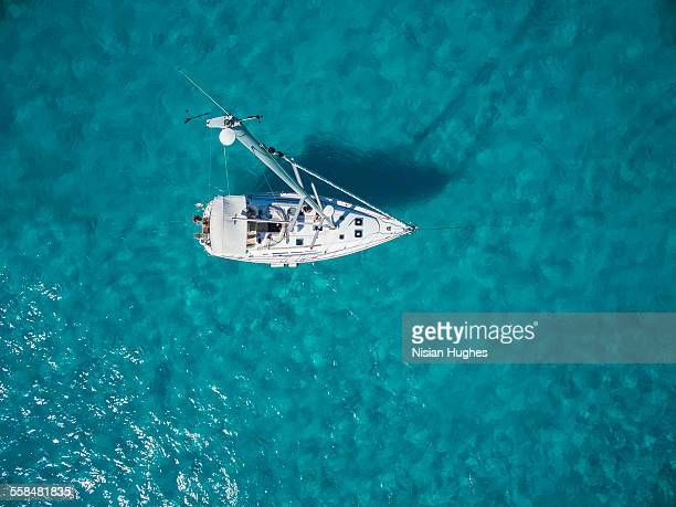 Aerial photo of sailboat anchored