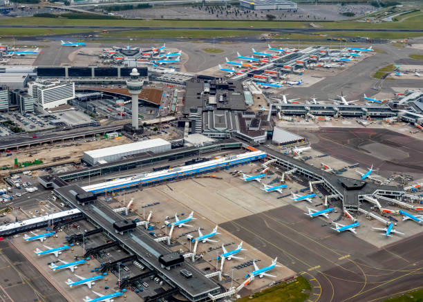 Aerial photo of Schiphol Airport, filled with parked KLM aircraft during the coronacrisis