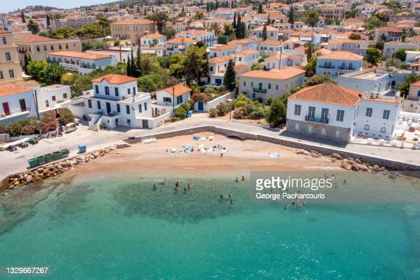 aerial photo of small beach on spetses island, greece - spetses stock pictures, royalty-free photos & images