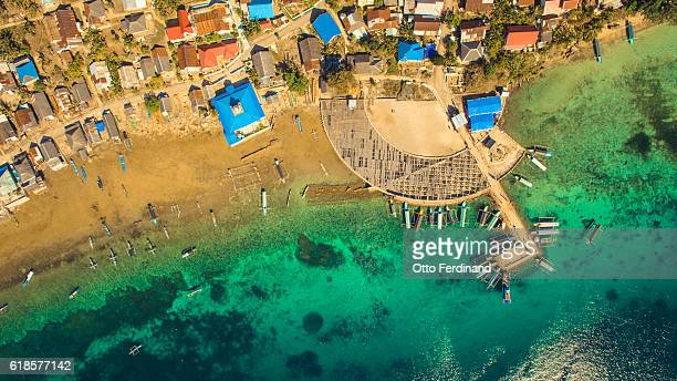 aerial photo of the pier of makasar island near bau-bau, southeast sulawesi - helicopter photos stock pictures, royalty-free photos & images