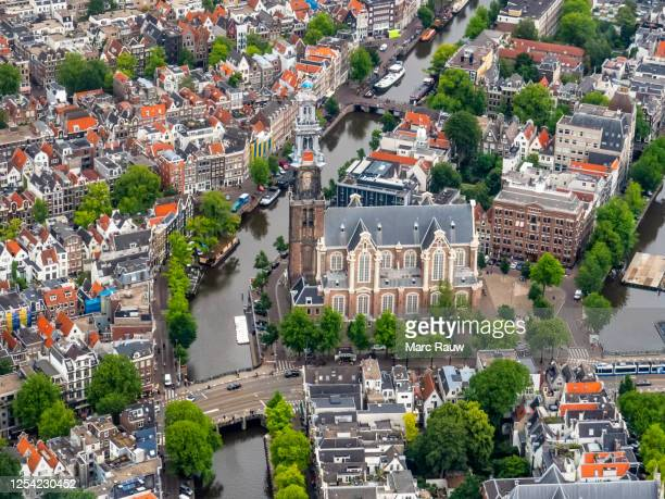 aerial photo of the westerkerk (western church) and the prinsengracht in amsterdam, the netherlands. - amsterdam stock pictures, royalty-free photos & images