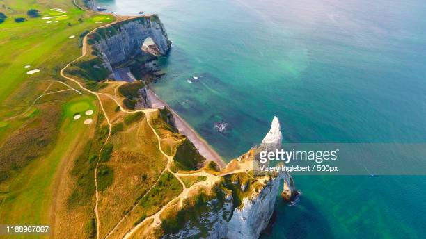 aerial photo of the white chalk cliffs in etretat - chalk rock stock pictures, royalty-free photos & images