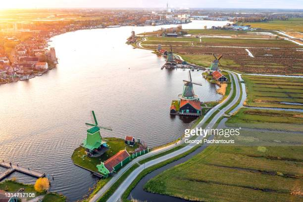 aerial photo of the windmills at zaanse schans at sunset - amsterdam stock pictures, royalty-free photos & images
