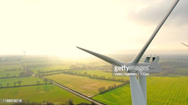 aerial photo of wind turbines at sunset in sainte pazanne, franc - mill stock pictures, royalty-free photos & images