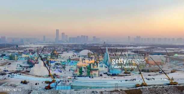 Aerial photo taken on December 17, 2020 shows ice and snow world under construction in Harbin, Heilongjiang Province, China. - PHOTOGRAPH BY Costfoto...