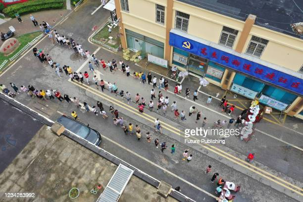 Aerial photo taken on July 29, 2021 shows urban residents queuing for nucleic acid testing in Huai 'an, Jiangsu Province, China.