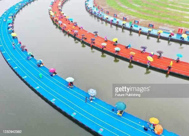 Aerial photo taken on May 15, 2021 shows the China Sihong Hongze Lake International Dayuan Pond Fishing Invitational Tournament in Suqian, Jiangsu...