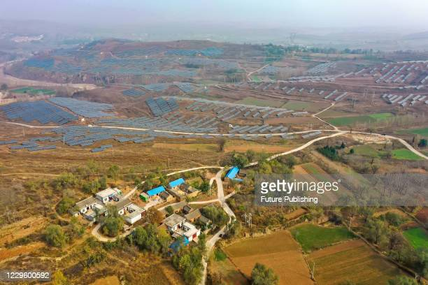 Aerial photo taken on Nov. 13, 2020 shows a photovoltaic project on the hillside of Guanyintang Forest Station in Pingdingshan City, Henan Province,...