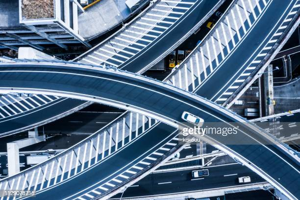 aerial photograph of beautifully curved highway. - built structure stock pictures, royalty-free photos & images