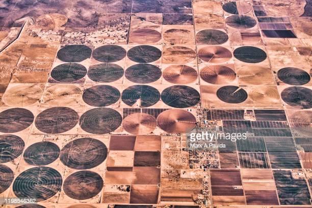 aerial photograph of circular crop fields - kornkreis stock-fotos und bilder
