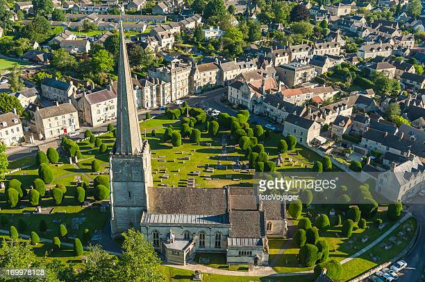 aerial photograph of idyllic english village cotswold church summer uk - overhemd en stropdas stock pictures, royalty-free photos & images