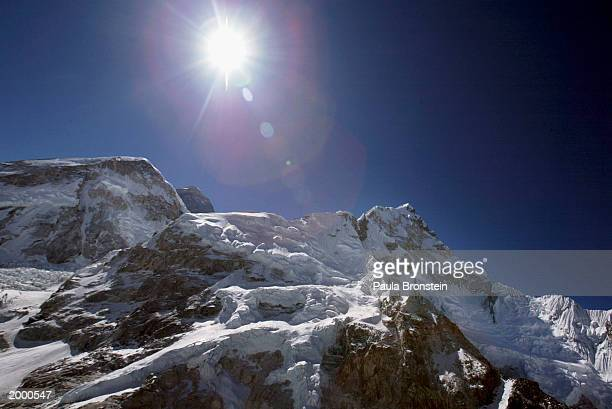 Aerial photograph of Mt Everest May 152003 peeking over its neighbours Lhotse 8501m and Nuptse 8848m on the Nepal Tibet border A record 1000 climbers...
