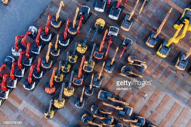 aerial photograph of outdoor warehouse of construction machine. - imperial system fotografías e imágenes de stock
